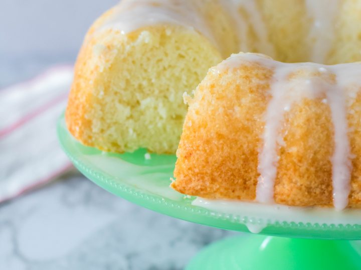 Mountain dew bundt cake on a green pedestal with a simple glaze.