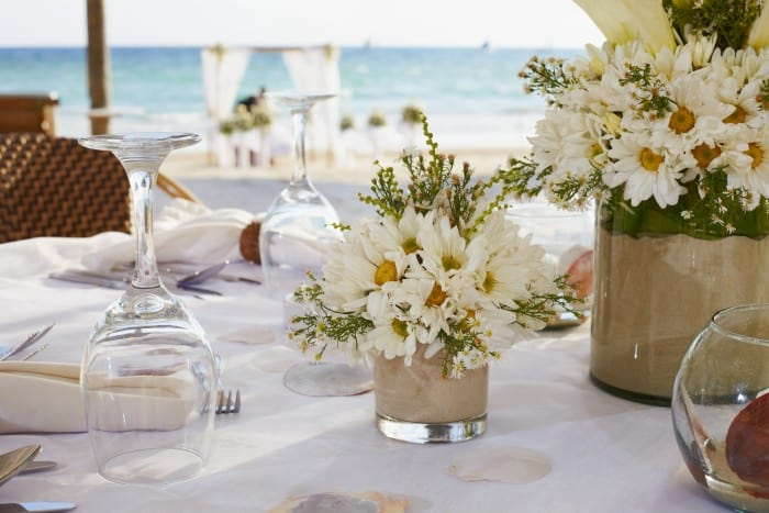 Keeping the centerpieces simple and low allow guests to still enjoy each others company during your next dinner party or big event!