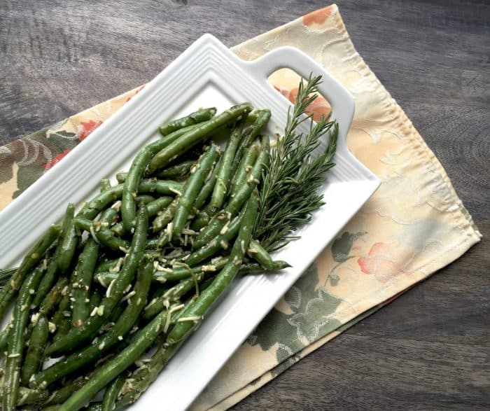 Parmesan Green Beans on a white rectangular plate