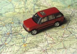Toy Car on a road map close up