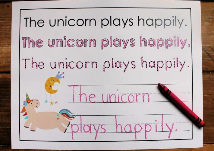 Printable sentence practice with a unicorn theme on a wooden background.