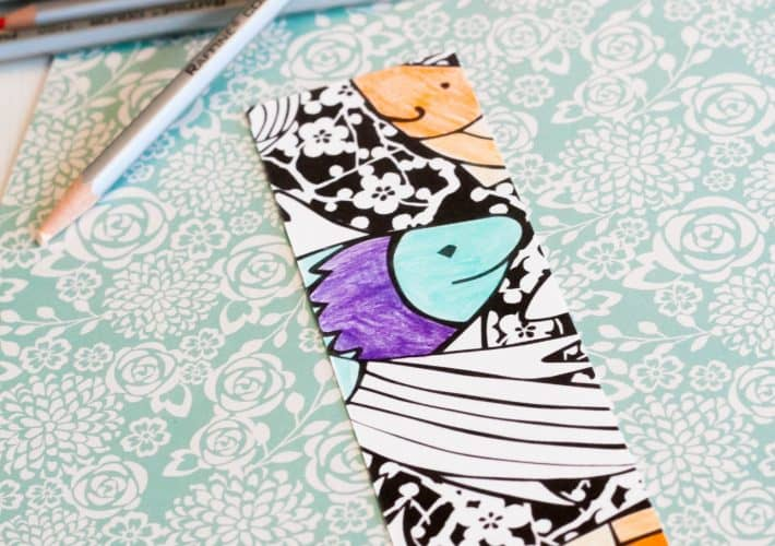 A printable fish bookmark for you to color.