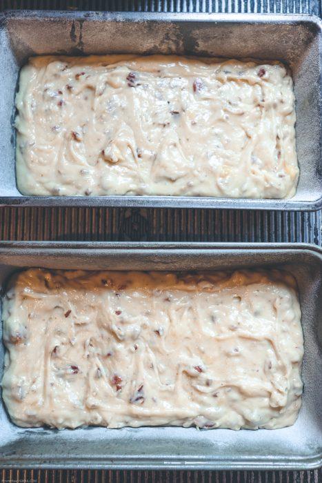 Banana pecan bread batter in bread pans.